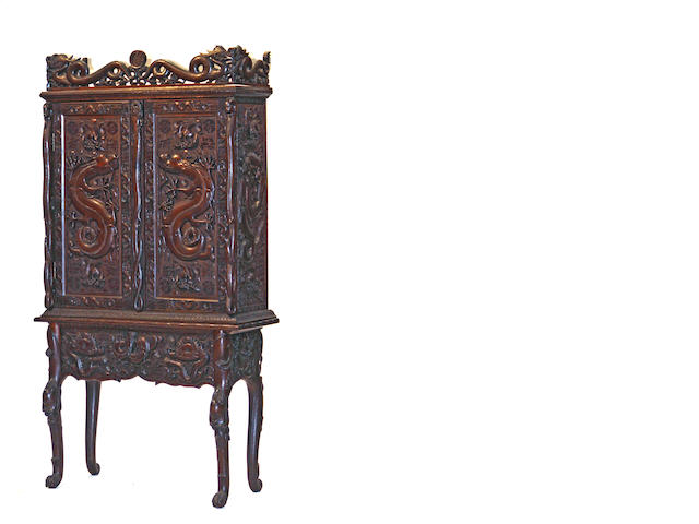 An Asian hardwood two-door cabinet on stand Early 20th Century