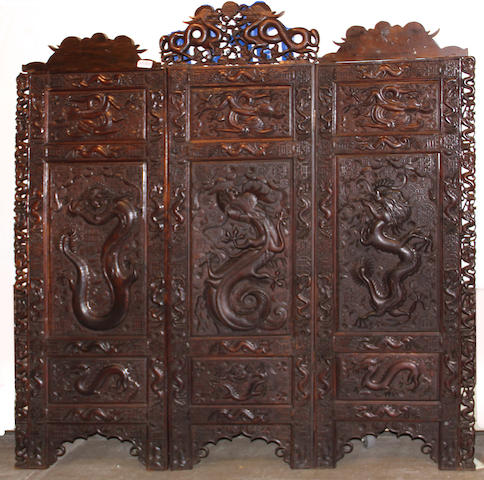 An Asian carved wood three-panel floor screen