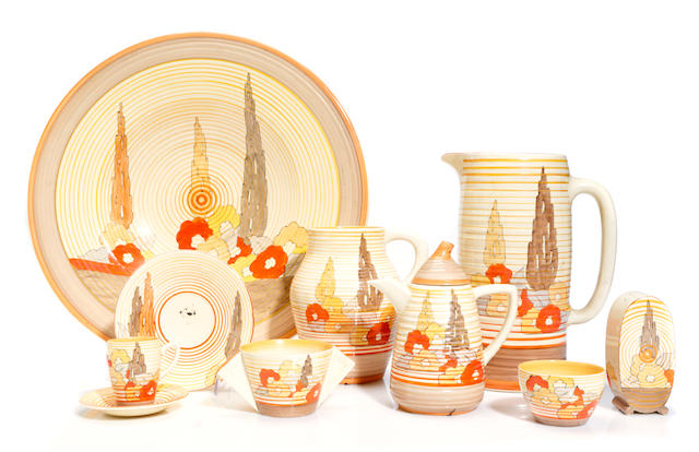 A group of Clarice Cliff glazed earthenware articles in the Capri Pattern