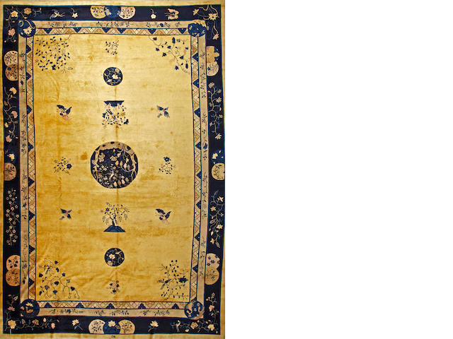 A Chinese carpet  China  size approximately 11ft. 11in. x 17ft. 2in.