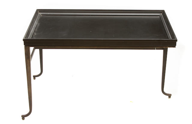 A John Saladino bronze and steel three-legged coffee table designed circa 1986