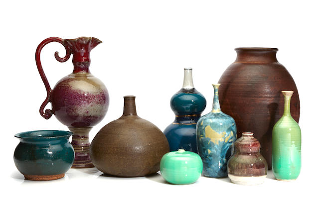 A group of ten glazed earthenware vases