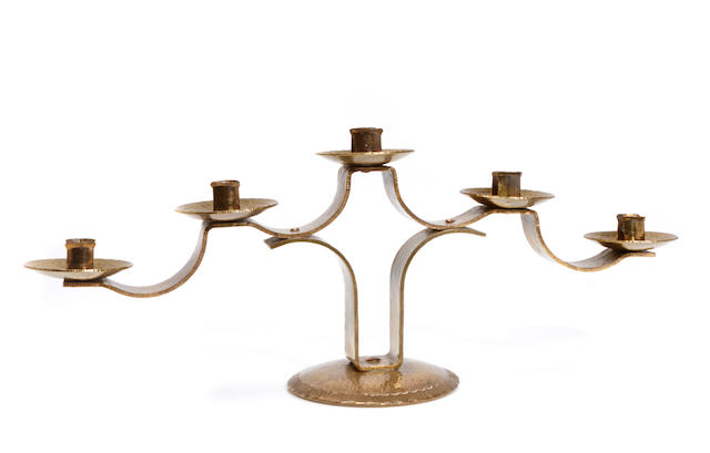 A Secessionist style hammered brass five light candelabrum