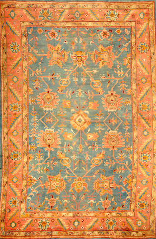 An Oushak carpet  West Anatolia size approximately 10ft. 9in. x 16ft.