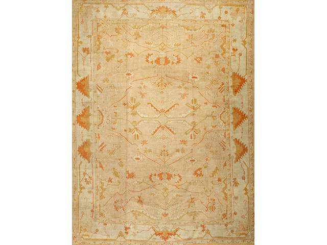 An Oushak carpet West Anatolia size approximately 10ft. 2in. x 13ft. 10in.