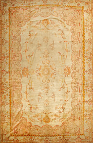 An Oushak carpet  West Anatolia size approximately 13ft. x 20ft.