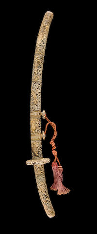 An ivory tachi carved with Buddhist figures The mounts by Kane Hakumin, Meiji period (late 19th century), the blade by Sukesada, Muromachi period (16th century)