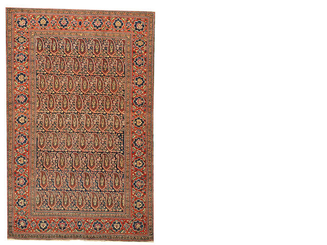 A Tabriz rug  Northwest Persia size approximately 4ft. 4in. x 6ft. 10in.
