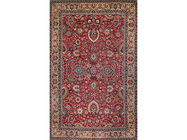 A Tehran carpet  Central Persia size approximately 12ft. x 19ft.