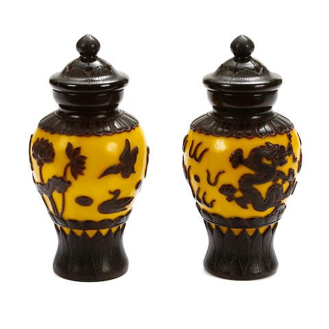 A pair of Peking overlaid glass covered jars