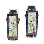 A pair of blue square form Chinese porcelain paint decorated vases