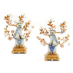 A pair of blue and white gilt bronze mounted porcelain Fu dogs