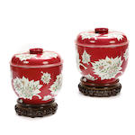 A pair of Chinese red paint decorated covered pots