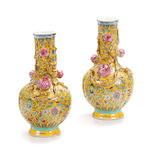 A pair of Chinese famille jaune porcelain vases