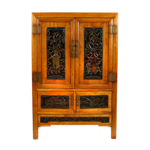 A large pair of Chinese hardwood cabinets