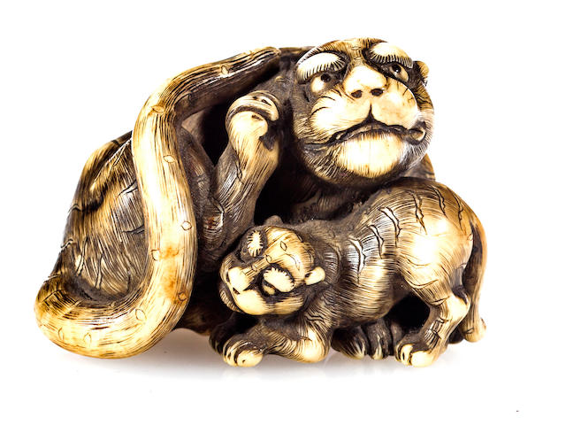 Ivory netsuke of tiger and cub, inscribed TOmotada (this is a nice netsuke but I think it has an added signature)