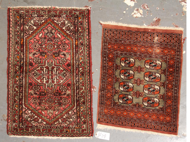 A pair of Rugs