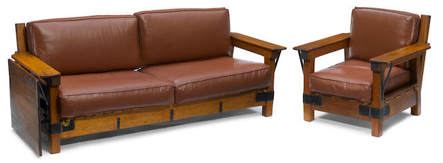 A Monterey leather-upholstered oak and wrought iron sofa and armchair