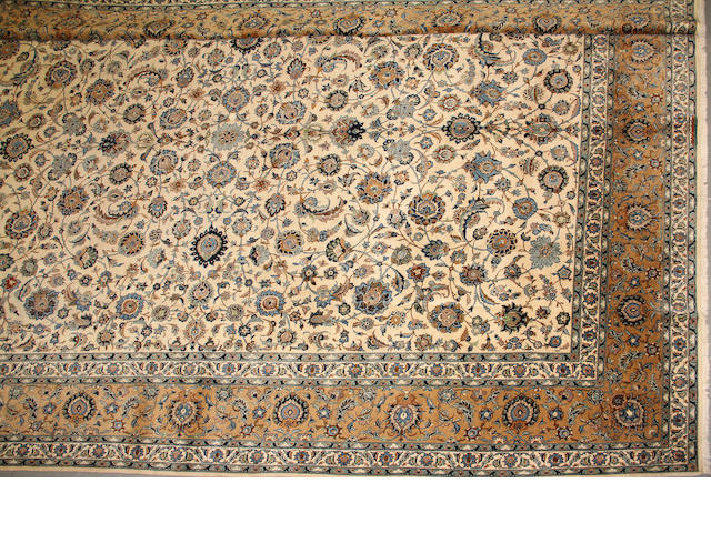 A Kashan carpet  size approximately 12ft. 2in. x 17ft. 2in.