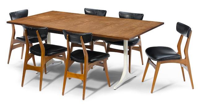 A George Nelson walnut and enameled metal pedestal dining table together with six George Nelson wood and leather chairs