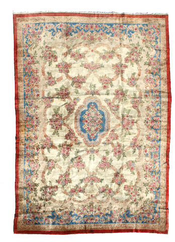 A Kerman Carpet  size approximately 11ft. 9in x 17ft. 3in