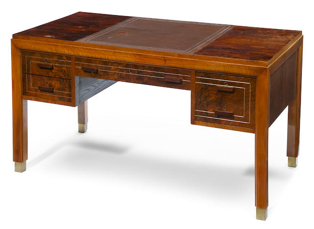 An Art Deco brass-mounted walnut and silvered metal inlaid desk circa 1930