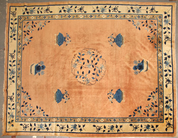 A Chinese carpet  size approximately 9ft. 2in. x 12ft.