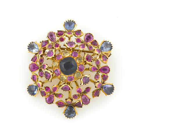 A gem-set and gold brooch