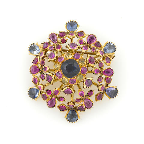 A gem-set and gold brooch