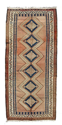 A Persian kilim size approximately 6ft. x 13ft. 5in.