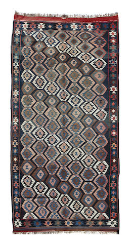 A Caucasian kilim size approximately 5ft. 6in. x 11ft. 6in.