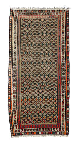 A Caucasian kilim runner size approximately 5ft. 2in. x 10ft. 6in.