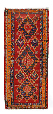 A Turkish kilim size approximately 5ft. x 11ft. 3in.