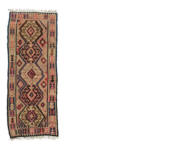 A Turkish kilim size approximately 3ft. 10in. x 10ft. 2in.