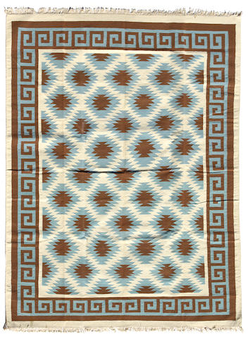 An Indian kilim size approximately 9ft. 3in. x 12ft. 3in.
