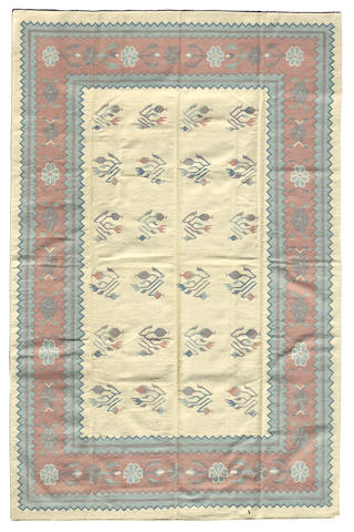 An Indian carpet  size approximatelty 9ft. 1in. x 12ft. 2in.