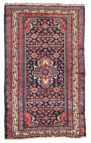A Bakhtiari rug size approximately 5ft. 4in. x 6ft. 2in.