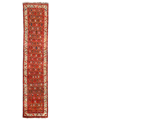 A Caucasian runner  size approximately 3ft. 4in. x 13ft. 4in.