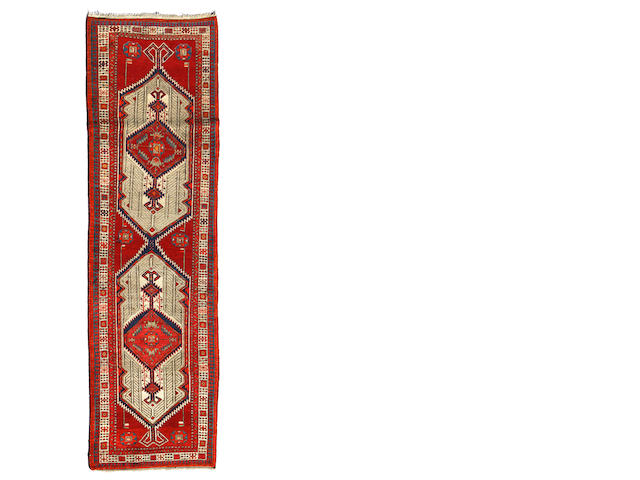 A Northwest Persian runner  size approximately 3ft. 4in. x 11ft.