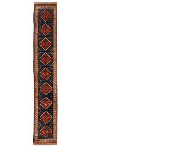 A Belouch runner  size approximately 3ft. 1in. x 17ft. 5in.