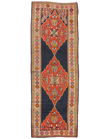 A Caucasian kilim size approximately 7ft. 7in. x 20ft. 8in.