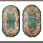 A pair of Chinese oval rugs  sizes approximately 3ft. x 5ft. each