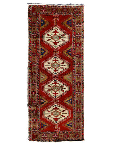 A Northwest Persian rug  size approximately 4ft. x 9ft.
