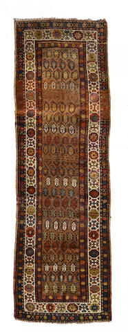 A Kurdish rug  size approximately 3ft. 4in. x 9ft. 6in.
