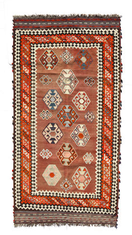 A Southwest Persian kilim size approximately 5ft. 1in. x 9ft. 9in.