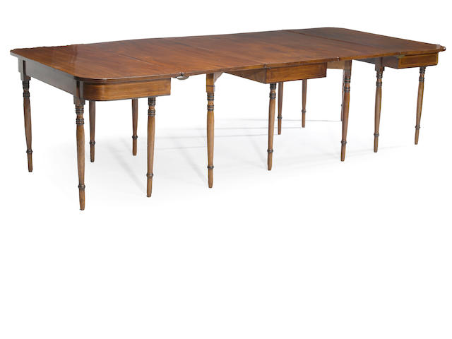 A Regency inlaid mahogany dining table<BR />first quarter 19th century