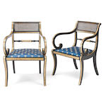 A pair of Regency ebonized and parcel gilt armchairs<BR />first quarter 19th century