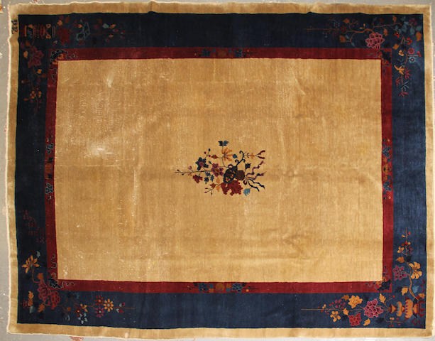 A Chinese carpet  size approximately 8ft. 11in. x 11ft. 7in.