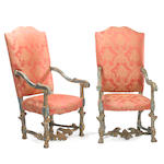 A pair of Baroque style painted and parcel gilt armchairs