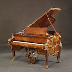 A Louis XV style gilt bronze mounted grand piano